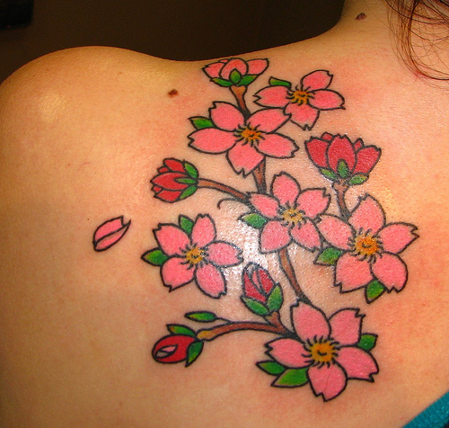 Flower foot tattoos can either be a cherry blossom, a rose, hibiscus,