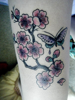 Cool Cherry Blossom Tattoos Displaying a most beautiful flower of cherry