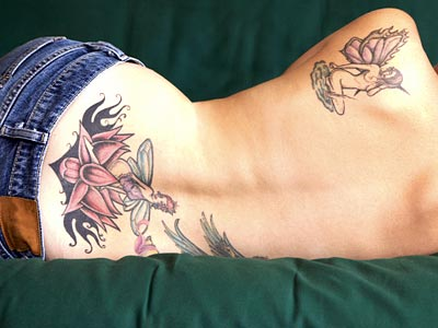 feminine back tattoos