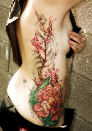girl flower tattoos. girl flower tattoos