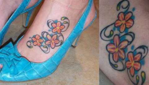heart and peace tattoos on bottom of foot