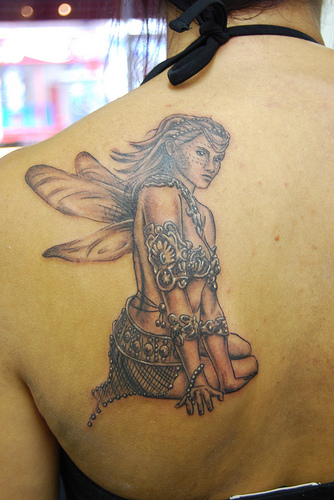 sitting fairy tattoos